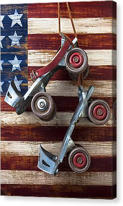 Rollar Skates With Wooden Flag Canvas Print by Garry Gay