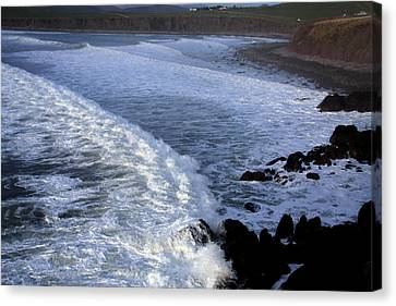 Rolling Waves Canvas Print by Aidan Moran
