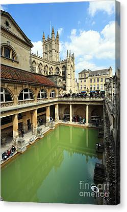 Roman Bath And Bath Abbey Canvas Print by Paul Cowan