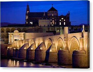 Roman Bridge And Mezquita In Cordoba At Dawn Canvas Print by Artur Bogacki