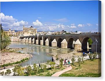 Roman Bridge In Cordoba Canvas Print by Artur Bogacki