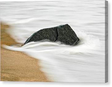 Surf Caresses A Lonely Stone Canvas Print