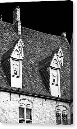 Rooftop View In Bruges Canvas Print by John Rizzuto
