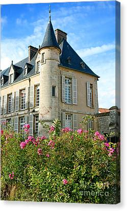 Roses At The Castle Canvas Print by Olivier Le Queinec