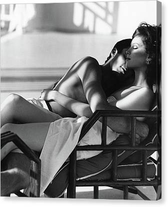 Chaise Canvas Print - Rosie Vela Resting In A Chair With A Male Model by Arthur Elgort