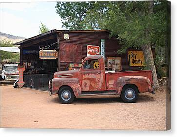 Route 66 Garage And Pickup Canvas Print by Frank Romeo