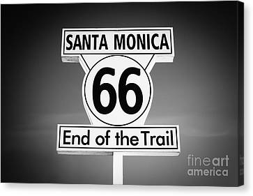 Route 66 Sign In Santa Monica In Black And White Canvas Print by Paul Velgos