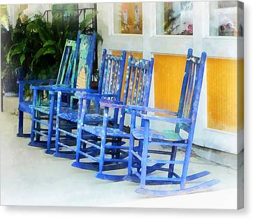 Row Of Blue Rocking Chairs Canvas Print by Susan Savad