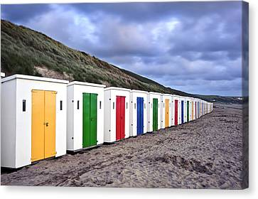 Row Of Colorful Beach Huts  Canvas Print by Matthew Gibson