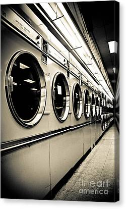 Laundry Mat Canvas Print - Row Of Washing Machines In Laundromat by Amy Cicconi