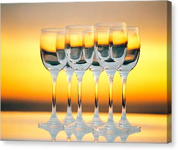 Row Of Wineglasses Against Golden Canvas Print