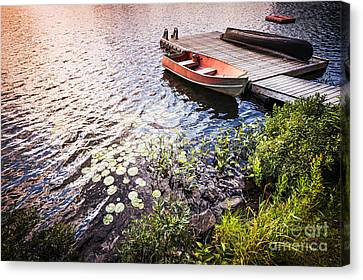 Rowboat At Lake Shore At Sunrise Canvas Print by Elena Elisseeva
