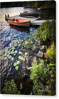 Rowboat At Lake Shore Canvas Print by Elena Elisseeva