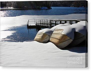 Canvas Print featuring the photograph Rowboats Resting In Winter by Rafael Quirindongo