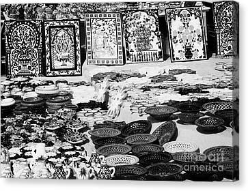 Rows Of Local Speciality Ceramics For Sale To Tourists On A Stall In The Souk Market In Nabeul Tunisia Canvas Print by Joe Fox