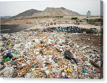 Rubbish On A Landfill Site Canvas Print by Ashley Cooper