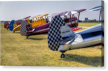 Rudders In A Row Canvas Print by Tim Stanley