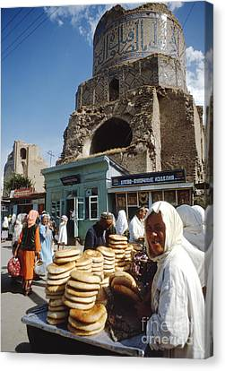 Ruins Of A Mosque With An Open Air Market Canvas Print by The Harrington Collection