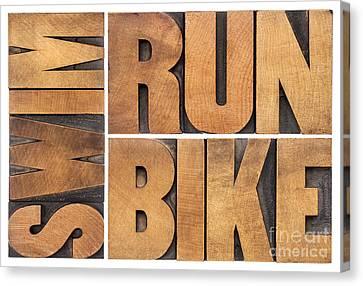 Canvas Print featuring the photograph Run Bike Swim - Triathlon Concept by Marek Uliasz