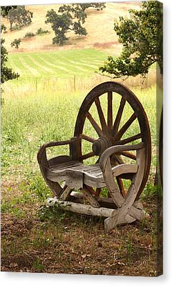 Rural Wagon Wheel Chair Canvas Print by Art Block Collections