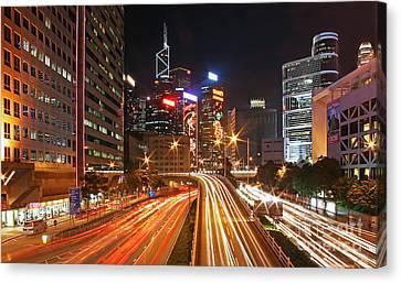 Rush Hour In Hong Kong Canvas Print by Lars Ruecker