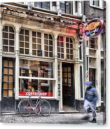 Rushing Past The Amsterdam Kafe Canvas Print by Mick Flynn
