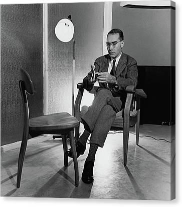 Russel Wright Sitting On A Chair Examining A Clay Canvas Print