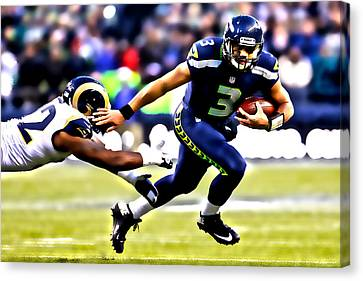 Russell Wilson On The Move Canvas Print by Brian Reaves