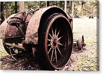 Rusted Big Wheels Canvas Print by Michael Spano