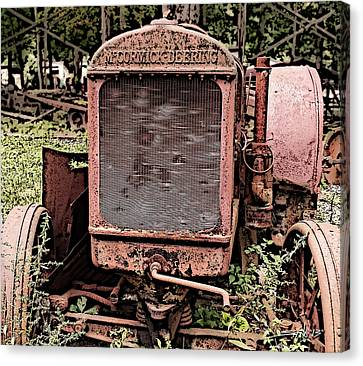 Rusted Mc Cormick-deering Tractor Canvas Print by Michael Spano