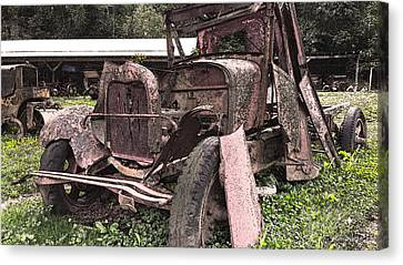Rusted Pickup In Pieces Canvas Print by Michael Spano