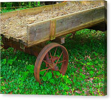Canvas Print featuring the photograph Rusted Wagon Wheel by Val Miller