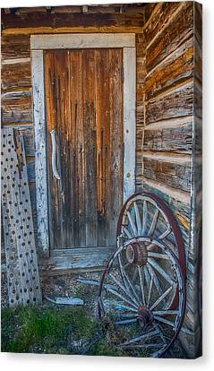 Rustic Door And Wagon Wheels Canvas Print