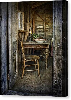 Rustic Doorway With Vintage Chair And Table Setting With Oil Lamp Canvas Print