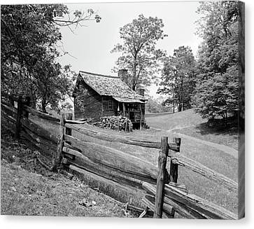 1880s Canvas Print - Rustic Log Cabin From 1880s Behind Post by Vintage Images