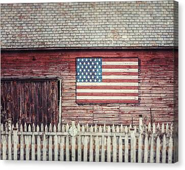Rustic Red Barn With American Flag  Canvas Print by Lisa Russo