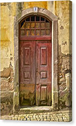 Rustic Red Wood Door Of The Medieval Village Of Pombal Canvas Print by David Letts