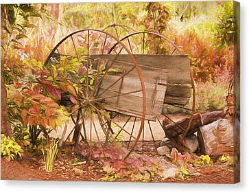 Rustic Wheels Canvas Print by Kim Hojnacki