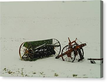 Rusting In The Snow Canvas Print by Jeff Swan