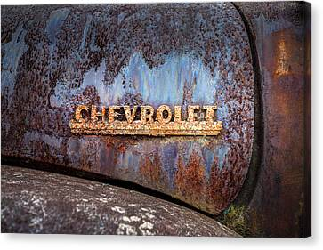 Canvas Print featuring the photograph Rusty Chevrolet - Nameplate - Old Chevy Sign by Gary Heller