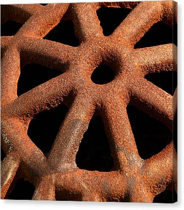 Rusty Drain Grate Canvas Print by Art Block Collections