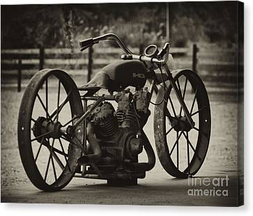 Rusty Rims Canvas Print by Wilma  Birdwell