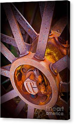 Rusty Spokes Canvas Print by Inge Johnsson