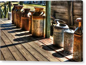 Rusty Western Cans 1 Canvas Print by Mel Steinhauer