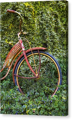 Rusty Wheel Canvas Print by Debra and Dave Vanderlaan