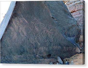 Saharan Elephant Carvings Canvas Print by Martin Rietze