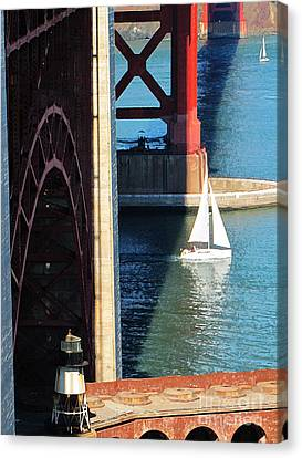 Sail Boat Passes Beneath The Golden Gate Bridge Canvas Print