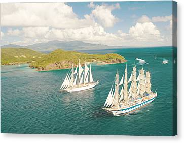 Sailboat Going Out Of Port With Full Sails Up Canvas Print by Lanjee Chee