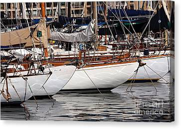 Sailboat Hulls In The Port Canvas Print by John Rizzuto