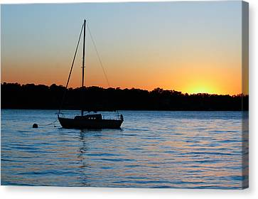 Sailboat Moored At Sunset Canvas Print by Ann Murphy